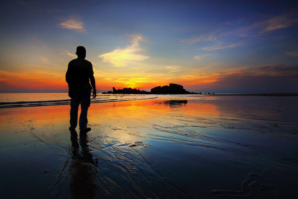 Vigil - lone man on a beach
